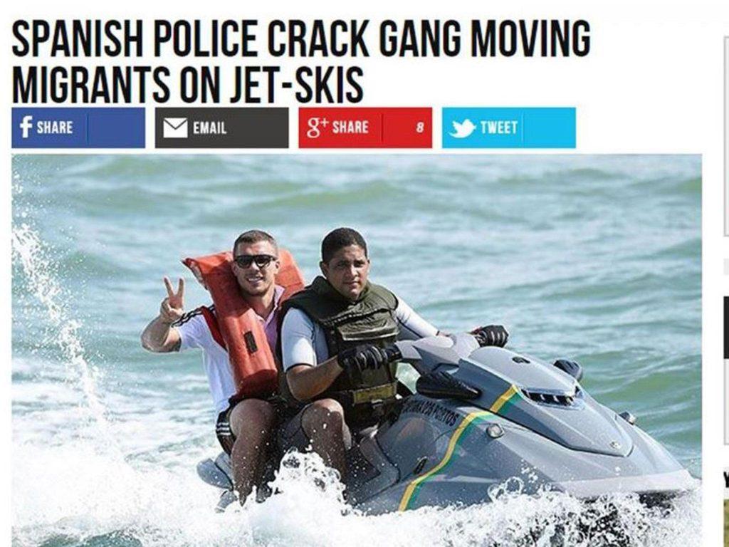 """Zwei Personen sitzen auf einem Jetski. Überschrift: """"Spanish Pilice Crack Gang Moving Migrants On Jet-Skis"""""""